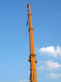 Urban auto yellow crane, blue sky, clouds stock images