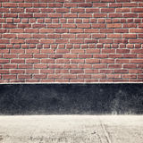 Urban background with brick wall and pavement Royalty Free Stock Photo