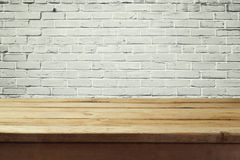 Urban background with empty wooden table and brick wall Stock Photography