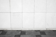 Urban background interior with white tiling on wall Stock Photo