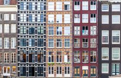 Urban background with residential building windows in Amsterdam royalty free stock photography