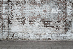 Urban background. White ruined industrial brick wall with copy space Stock Images