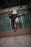 Urban ballerina stretching her leg Stock Photography