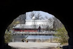 Urban Barn. This is a Spring picture of the Urban Barn at the Lincoln Park Zoo as seen from the pedestrian underpass and across the South Pond, it is  located Royalty Free Stock Photos