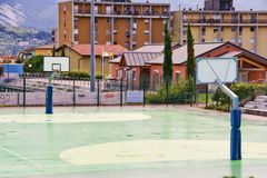 Urban basketball ground. Basketball ground in the middle of the residential area Royalty Free Stock Photo