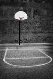 Urban Basketball Hoop Inner City Wall and Asphalt Stock Photography