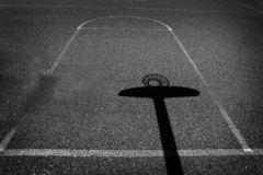 Urban Basketball Shadow Aspalt Sports Competition. Urban basketball court with shadows on aspalt for sports competition stock photo