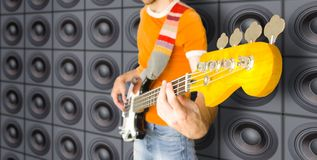 Urban Bass Guitar Player. (Against Wall Of Speakers Stock Photography