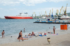 Urban beach in Feodosia background Seaport Stock Photography