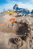 Children's toys in the sand at the beach. Royalty Free Stock Photos