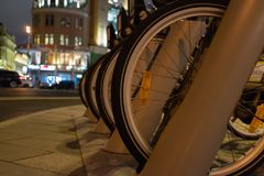 Urban bicycle parking. At night on the building background Royalty Free Stock Images