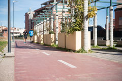 Urban bicycle path in city park Stock Image