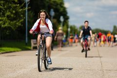 Urban bicycle - teenage girl and boy cycling Stock Photography