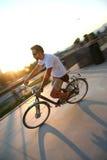 Urban biking. Man on a bike in the city stock photography