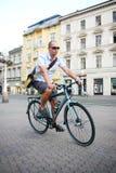 Urban biking. Man on a bike in the city Stock Photos