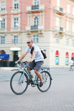 Urban biking. Man on a bike in the city Stock Images
