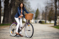Urban biking - middle-age woman and bike in city Royalty Free Stock Photos