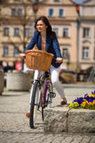 Urban biking - middle-age woman and bike in city Stock Photos