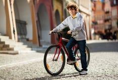Urban biking - teenage boy and bike in city Stock Images