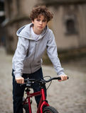 Urban biking - teenage boy and bike in city Royalty Free Stock Image