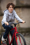 Urban biking - teenage boy and bike in city Stock Photos
