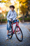 Urban biking - teenage boy and bike in city Stock Image