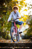 Urban biking - teenage boy and bike in city Royalty Free Stock Photo
