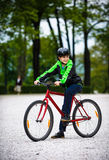Urban biking - teenage boy and bike in city Stock Images