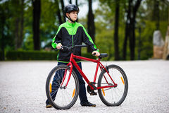 Urban biking - teenage boy and bike in city Stock Photography