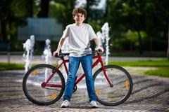 Urban biking - teenage boy and bike in city Royalty Free Stock Photo