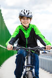 Urban biking - teenage boy and bike in city Stock Photography