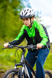 Urban biking - teenage boy and bike in city Stock Image