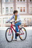 Urban biking - teenage boy and bike in city Stock Photo