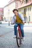 Urban biking - teenage boy and bike in city Royalty Free Stock Photography