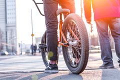 Urban biking - teenage boy riding bike in city. Expects a pedestrian crossing stock photography