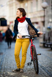 Urban biking - teenage girl and bike in city Royalty Free Stock Photography