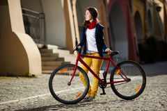 Urban biking - teenage girl and bike in city Stock Images