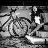 Urban biking - teenage girl and bike in city Stock Image
