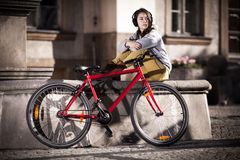 Urban biking - teenage girl and bike in city royalty free stock photos