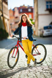 Urban biking - teenage girl and bike in city Royalty Free Stock Photo