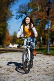 Urban biking - teenage girl and bike in city Royalty Free Stock Image