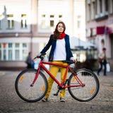 Urban biking - teenage girl and bike in city Royalty Free Stock Image