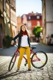 Urban biking - teenage girl and bike in city Royalty Free Stock Photo