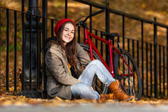 Urban biking - teenage girl and bike in city Royalty Free Stock Photography