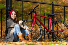 Urban biking - teenage girl and bike in city Stock Image