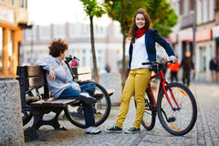 Urban biking - teens and bikes in city stock photo