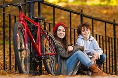 Urban biking - teens and bikes in city Royalty Free Stock Images