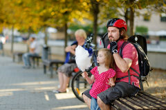 Urban biking - young father with a child in a city Stock Image