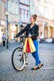 Urban biking - young woman and bike in city Stock Photo