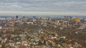 Urban bird`s eye view of cityscape with buildings in Dnipro city. Urban bird`s eye view from drone of Dnipro city downtown. Above cityscape with buildings on royalty free stock images
